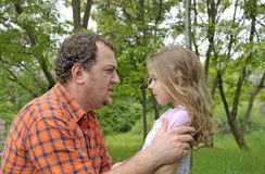 Father discipline his daughter Royalty Free Stock Photography