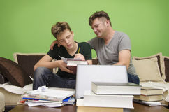 Father doing homework with his son Royalty Free Stock Image