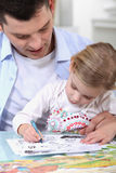 Father drawing with daughter Royalty Free Stock Image