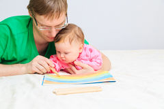 Father drawing with newborn daughter Royalty Free Stock Photo