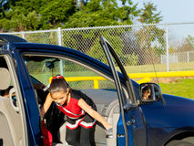 Father Drives Daughter to Cheerleader Practice Stock Images