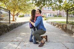 Father Dropping Off Daughter In Front Of School Gates royalty free stock photo