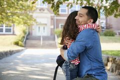 Father Dropping Off Daughter In Front Of School Gates stock photos