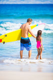 Father and Duagher on the Beach Going Surfing Royalty Free Stock Image