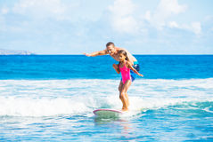 Father and Duaghter Surfing Together Stock Photography