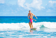 Father and Duaghter Surfing Together Royalty Free Stock Photo