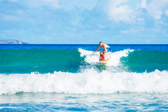 Father and Duaghter Surfing Together Royalty Free Stock Image