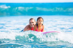 Father and Duaghter Surfing Together Royalty Free Stock Photography