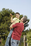 Father embrace son. And child looking in camera, concept of happy family Stock Photos