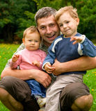 Father embracing children Stock Photography