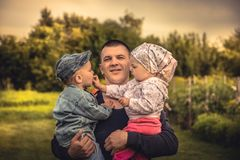 Father embracing children son and daughter in countryside concept happiness parenting stock image