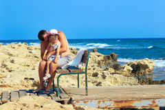 Father embracing and comforting his sad and pouting baby daughte. R outside on a  summer day Royalty Free Stock Photo