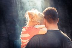 Father embracing daughter family lifestyle concept for togetherness and parenting rear view stock images