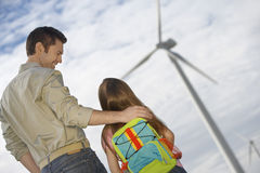 Father Embracing Daughter At Wind Farm Royalty Free Stock Image