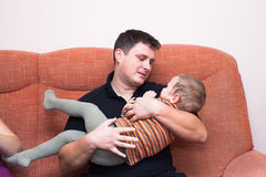 Father embracing his child boy. At home Royalty Free Stock Photos