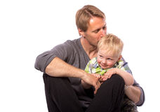 Father embracing his son. Happy family of father embracing his son smiling looking at camera isolated on white background waist up with copy place stock images