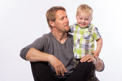 Father embracing his son. Happy family of father embracing his son smiling looking at camera isolated on white background waist up with copy place Royalty Free Stock Photos