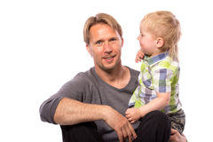 Father embracing his son. Happy family of father embracing his son smiling looking at camera isolated on white background waist up with copy place Stock Image