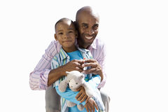 Father embracing son, smiling, portrait, cut out royalty free stock photos