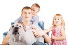 Father with english bulldog is sitting on a chair. Stock Images