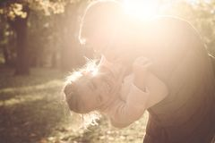 Father enjoying in autumn day with daughter. Close up stock photo