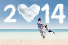 Father enjoying new year time at beach Royalty Free Stock Photo
