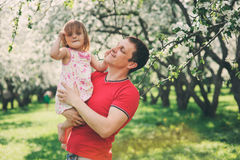 Father enjoying spring walk with kid daughter. Father enjoying spring walk with happy kid daughter stock image