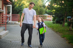 Father escorted to school by his son. Stock Photography