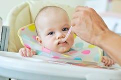 Father feeding baby Royalty Free Stock Photo
