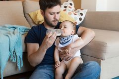 Father feeding baby Stock Photography