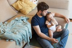 Father feeding baby Royalty Free Stock Image