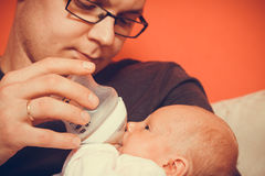 Father feeding from bottle newborn baby Stock Photography