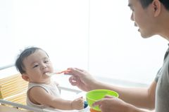 Father feeding child food. Stock Images