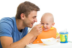 Father feeding kid son Royalty Free Stock Photography