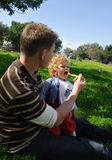 Father feeding son Stock Images