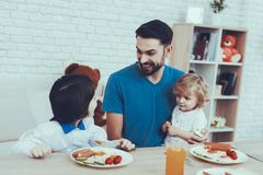 Father is Feeding a Sons a Breakfast stock images