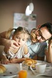 Father feeds his daughter. royalty free stock images