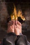 father feet fireplace s son warming Στοκ φωτογραφίες με δικαίωμα ελεύθερης χρήσης