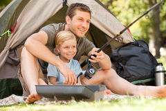Father fishing with his son. Father camping and fishing with his son Stock Photography