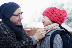 Father fixing daughter's scarf Royalty Free Stock Image