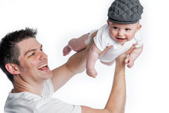 Father Flying Baby with Flat Cap Royalty Free Stock Images