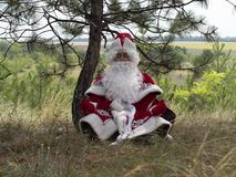 Father Frost meditates outdoors. stock image