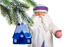 Father Frost (Santa Claus) and the toy house Royalty Free Stock Photo