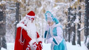 Father Frost showing his Snow Maiden the gift for her stock video