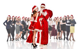 Father frost and woman in red xmas dress Stock Photography