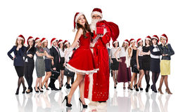 Father frost and woman in red xmas dress Stock Photos