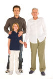 Father gandfather with son nephew standing on white background Royalty Free Stock Photo
