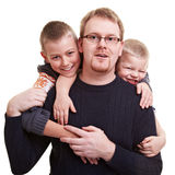 Father gets hugged by his sons Royalty Free Stock Image