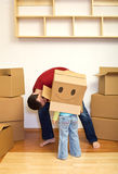 Father and girl playing with cardboard boxes Royalty Free Stock Image