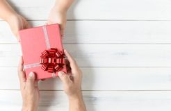 Father gives chrismas gift to his son stock photo